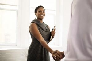 identity woman shaking hands